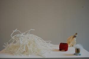 Charlotte Jonerheim Excavation I 2012-13 Exhibit 1, fringe & wax. Exhibit 2, porcelain figure & surgical gloves. Exhibit 3, plaster, pigment, & bangle. Exhibit 4, porcelain, lamp holder & thread