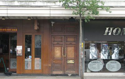 the exterior of Notting Hill Arts Club. Sandwiched between a restaurant & a hair salon, you have to be in the know to realise what's beyond the wooden doors... 'small basement, big fun' nottinghill.london.myvillage.com