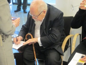 Peter Blake signs my copy of the Four Decades publication from Chelsea Futurespace