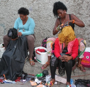 Street side hairdressers in Downtown Kingston, Jamaica. Photograph by WhittyGordon Projects.