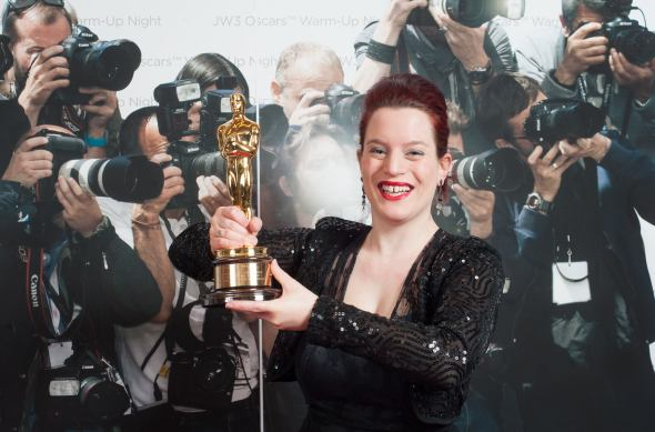 holding a real Oscar at JW3's Oscars Warm - Up Night. Photograph by Blake Ezra Photography.